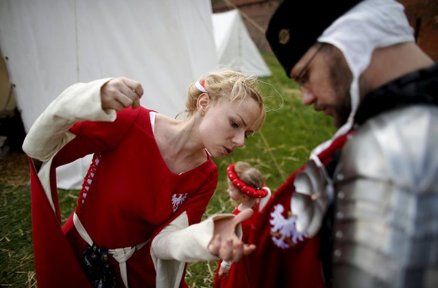 Members of the Polish team make final preparations before taking part in the opening ceremony parade of the Medieval Combat World Championship at Malbork Castle, northern Poland, April 30, 2015. (Photo by Kacper Pempel/Reuters)