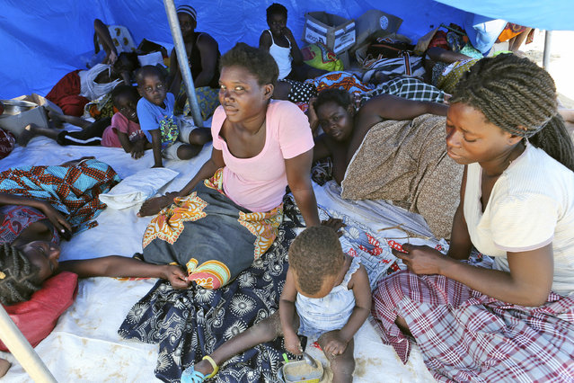 Families are seen inside a tent at a camp for displaced survivors of cyclone Idai in Beira, Mozambique, Tuesday, April, 2, 2019. Mozambican and international health workers raced Monday to contain a cholera outbreak in the cyclone-hit city of Beira and surrounding areas, where the number of cases has jumped to more than 1,000. (Photo by Tsvangirayi Mukwazhi/AP Photo)