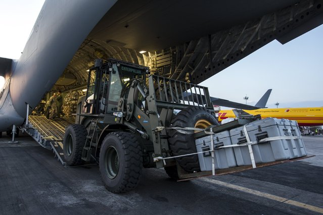A vehicle is unloaded from an U.S. Air Force C-17A Globemaster III aircarft after it landed at Tribhuvan International in Kathmandu, Nepal, May 5, 2015. (Photo by Athit Perawongmetha/Reuters)