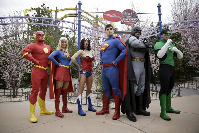 Actors dressed as Flash, Superwoman, Wonder Woman, Superman, Batman and Green Lantern (L to R), members of the Justice League, pose during the season inauguration of the Madrid Warner amusement park in San Martin de Valdeiglesias, near Madrid, Spain, March 18, 2016. (Photo by Andrea Comas/Reuters)