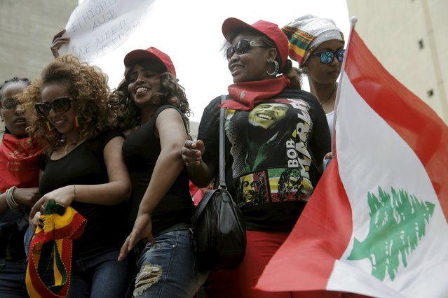 Migrant domestic workers dance with a Lebanese flag during a parade in Beirut, to support the rights of migrant domestic workers in Lebanon and calling for a domestic workers union in Beirut May 3, 2015. (Photo by Alia Haju/Reuters)