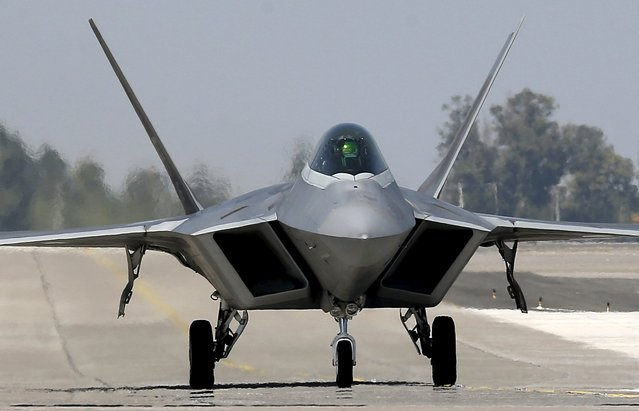 A U.S. Air Force F-22 Raptor fighter jet is seen after a performance ahead of the International Air and Space Fair (FIDAE) at the Arturo Merino Benitez international airport in Santiago, Chile March 29, 2016. (Photo by Rodrigo Garrido/Reuters)