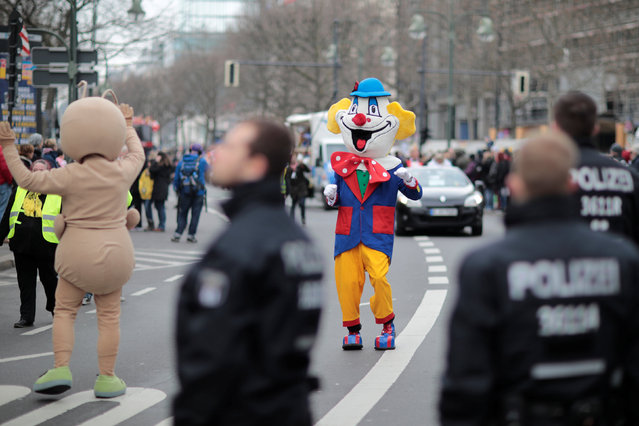 Police officers watch a carnival celebration in Berlin, Germany February 19, 2017. (Photo by Axel Schmidt/Reuters)