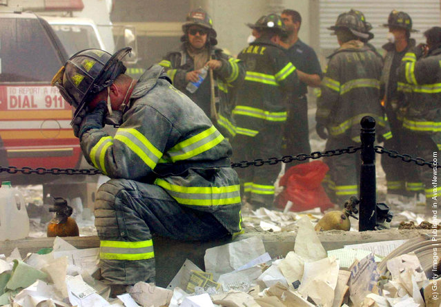 A firefighter breaks down after the World Trade Center buildings collapsed September 11, 2001