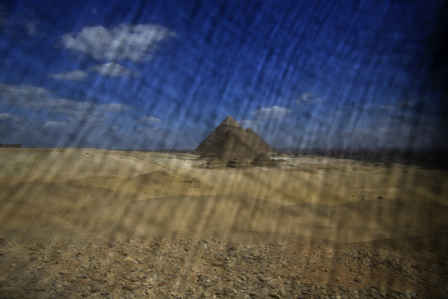 This Thursday, April 9, 2015 photo shows the historical site of the Giza Pyramids near Cairo. (Photo by Hassan Ammar/AP Photo)