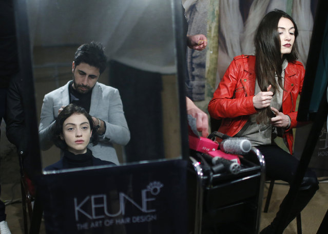 A model has her hair done during Tbilisi Fashion Week in Tbilisi, Georgia, April 1, 2016. (Photo by David Mdzinarishvili/Reuters)