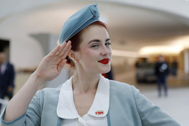Pearls Daily wears a vintage TWA stewardess uniform while greeting visitors to the TWA Hotel at New York's John F. Kennedy International Airport, Wednesday, May 15, 2019. (Photo by Mark Lennihan/AP Photo)