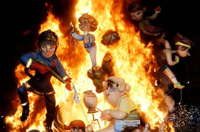 Satirical sculptures burn during the traditional Fallas festival in Valencia, Spain, on Wednesday, March 19, 2014. (Photo by Alberto Saiz/Associated Press)