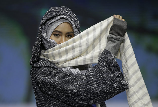 In this May 3, 2019, photo, model displays a creation by Rosie Rahmadi during the Muslim Fashion Festival in Jakarta, Indonesia. The event was held to greet the upcoming holy fasting month of Ramadan. (Photo by Achmad Ibrahim/AP Photo)