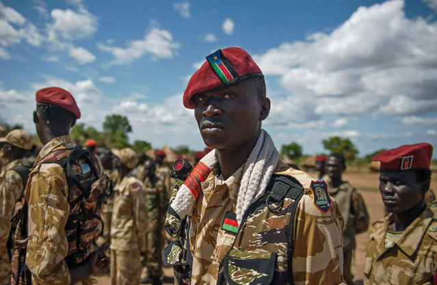 The Sudan People's Liberation Army (SPLA) soldiers stand at attention at a containment site outside Juba on April 14, 2016. The soldiers at the site are the Tiger Battalion of the presidential guard consisting of a total of 700 soldiers. The site is about 30 km outside of Juba as per the transitional security arrangements of the South Sudan peace agreement. The demilitarisation of Juba is an important part of the peace agreement of the cessation of hostilities signed in August 2015 and seen as a way forward to forming the transitional government of national unity. (Photo by Charles Lomodong/AFP Photo)