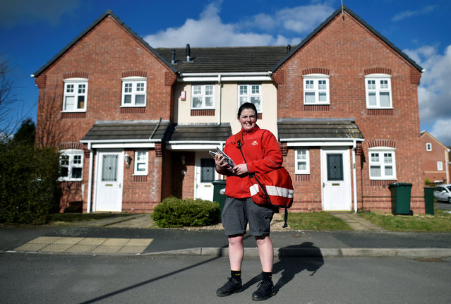"""Cilene Connolly, 32, a Royal Mail postwoman, poses for a portrait during her postal round on a residential street in Coventry, Britain, February 24, 2017. """"Fortunately, I haven't been faced with gender inequalities in my role as a postwoman"""", Connolly said. """"I've had a great response from my customers for being a female delivering their post, women in particular are always pleasantly surprised to see a female face"""". (Photo by Hannah McKay/Reuters)"""