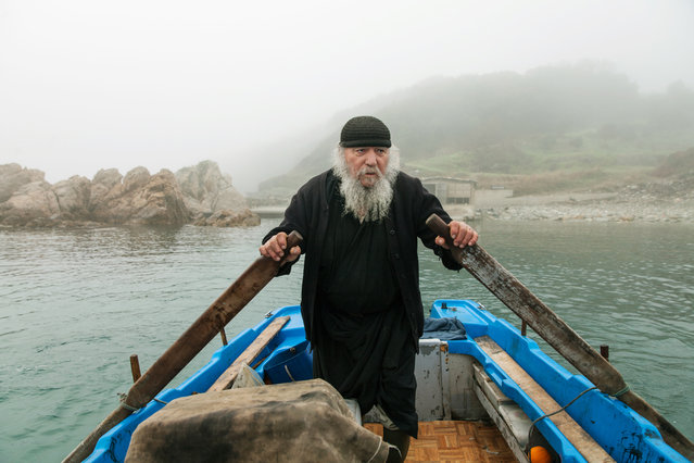 """""""The Monk"""". Mount Athos is not just one thing – it is many things combined; and each monk with his own personal history. They chant along with the sounds of nature, uniquely tuned to a divine frequency. Peaceful, calm, restful. You can hear about all the miracles that have occurred and changed the lives of people within and without the place. (Photo and caption by Dimitris Vlaikos/National Geographic Photo Contest)"""