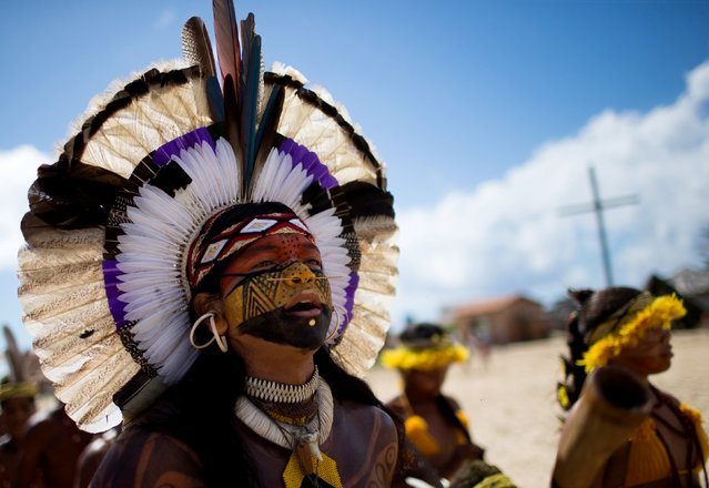 Native Brazilians sing and dance, during the Indigenous Youth Games of Pataxos nation in Santa Cruz de Cabralia, Bahia state, Brazil, April 17, 2016. (Photo by Roosevelt Cassio/Reuters)