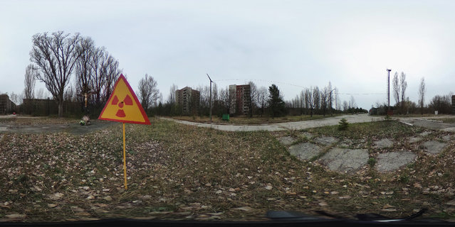 A sign warning of radiation contamination stands near former apartment buildings on April 9, 2016 in Pripyat, Ukraine. Pripyat, built in the 1970s as a model Soviet city to house the workers and families of the Chernobyl nuclear power plant, now stands abandoned inside the Chernobyl Exclusion Zone, a restricted zone contaminated by radiation from the 1986 meltdown of reactor number four at the nearby Chernobyl plant in the world's worst civilian nuclear accident that spewed radiaoactive fallout across the globe. (Photo by Sean Gallup/Getty Images)