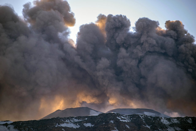 Smoke billows from the Mt. Etna's volcano, near Catania, in Sicily, southern Italy, Thursday, March 16, 2017. Volcanic rocks and steam injured at least 10 people, including tourists and a scientist, following an explosion on Sicily's Mount Etna Thursday, witnesses and media reported. (Photo by Salvatore Allegra/AP Photo)