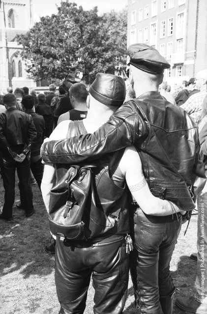 A gay couple at an S&M Pride march, London, 9th September 1995
