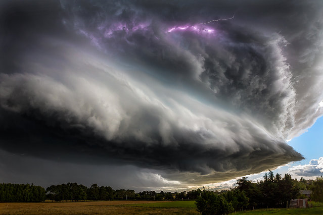 """Thunderstruck"". Summer stom. A super cell formed off the coast of New Zealand, intensified and swept across Christchurch and North Canterbury, February 23, 2014. Photo location: Christchurch, New Zealand. (Photo and caption by David Hardy/National Geographic Photo Contest)"