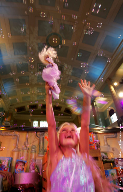 10 year old Lili Dixon plays with her Barbie Pegasus Annika toy at the Dream Toys 2005 Pre-Christmas Expo