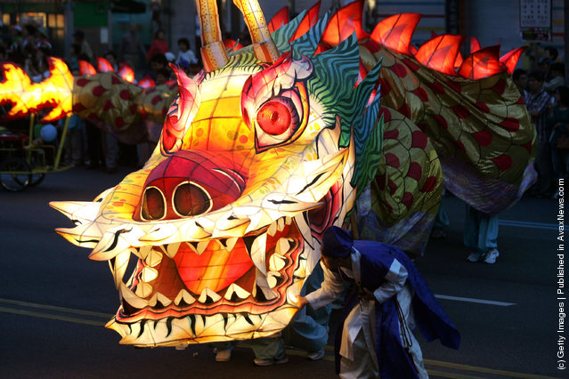 South Korean Buddhists carry colorful dragon as they celebrate the forthcoming birthday of Buddha