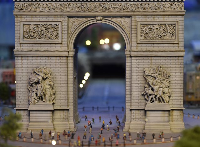 A miniature model of  the Arc de Triomphe in Paris, France, part of Gulliver's Gate, a miniature world being recreated in a 49,000-square-foot exhibit space in Times Square, is seen during a preview April 10, 2017 in New York City. (Photo by Timothy A. Clary/AFP Photo)
