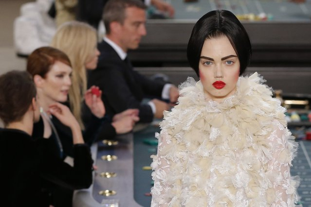 A model presents a creation by German designer Karl Lagerfeld as part of his Haute Couture Fall Winter 2015/2016 fashion show for French fashion house Chanel at the Grand Palais which is transformed into a casino in Paris, France, July 7, 2015. (Photo by Stephane Mahe/Reuters)