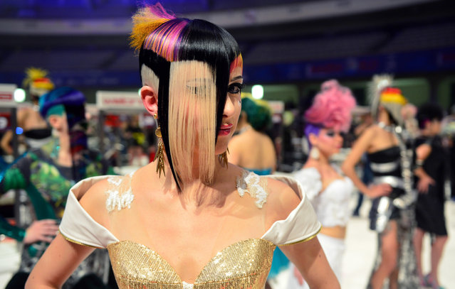 """A model waits after the contest """"Full Fashion Look"""" for the rating of the jury during the OMC Hairworld World Cup on May 4, 2014 in Frankfurt am Main, Germany. (Photo by Thomas Lohnes/Getty Images)"""