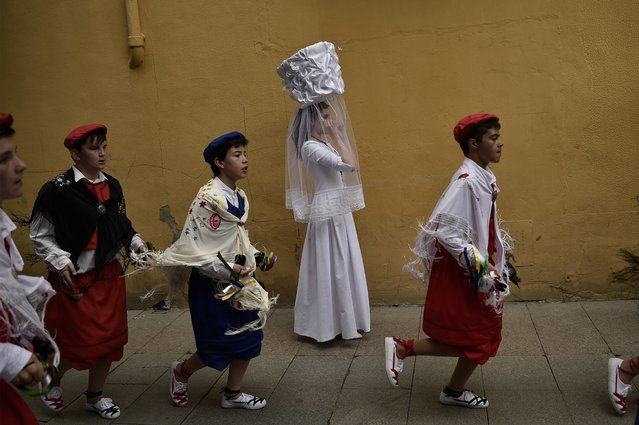 "A participant of  ""Bread Procession of the Saint"", takes part in the ceremony in honor of Domingo de La Calzada Saint (1019-1109) who helped poor people and pilgrimage, in Santo Domingo de La Calzada, northern Spain, Wednesday, May 11, 2016. (Photo by Alvaro Barrientos/AP Photo)"