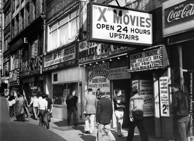1975:  A p*rn shop with cinema and live shows in New York's Times Square area