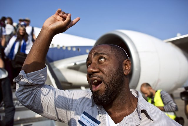 A newly arrived Jewish immigrant from North America reacts after disembarking from an airplane at Ben Gurion International Airport near Tel Aviv July 14, 2015. (Photo by Nir Elias/Reuters)