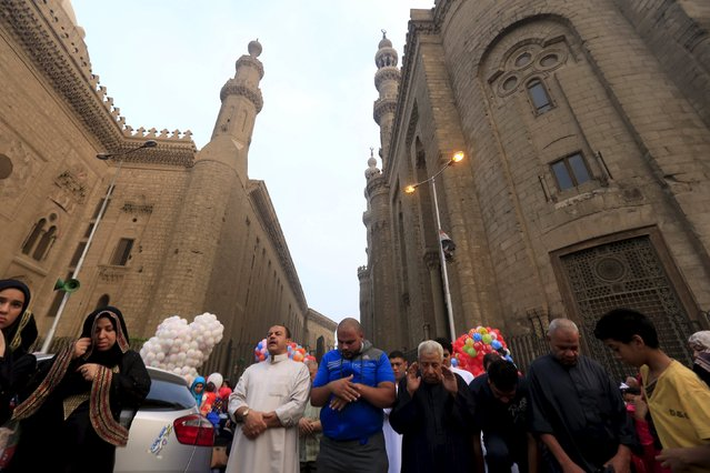 Egyptian Muslims perform Eid-al-Fitr prayers in front of Al Sultan Hassan (L) and Al-Refaie (R) mosques in the old Islamic area of Cairo, Egypt, July 17, 2015. Eid-al-Fitr marks the end of the Muslim fasting month of Ramadan, the holiest month in the Islamic calendar. (Photo by Amr Abdallah Dalsh/Reuters)