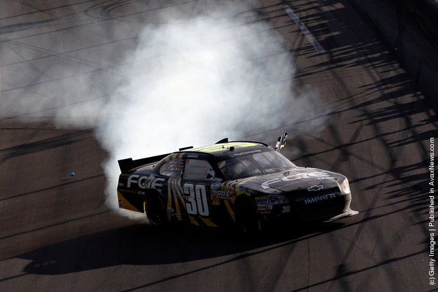 James Buescher, driver of the #30 Fraternal Order of Eagles Chevrolet, celebrates with a burnout after winning the NASCAR Nationwide Series DRIVE4COPD 300 at Daytona International Speedway