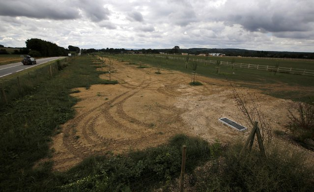 A farm field remains where German prisoners of war were interned following the D-Day landings in Normandy in Nonant-le-Pin, France, August 24, 3013. REUTERS/Chris Helgren