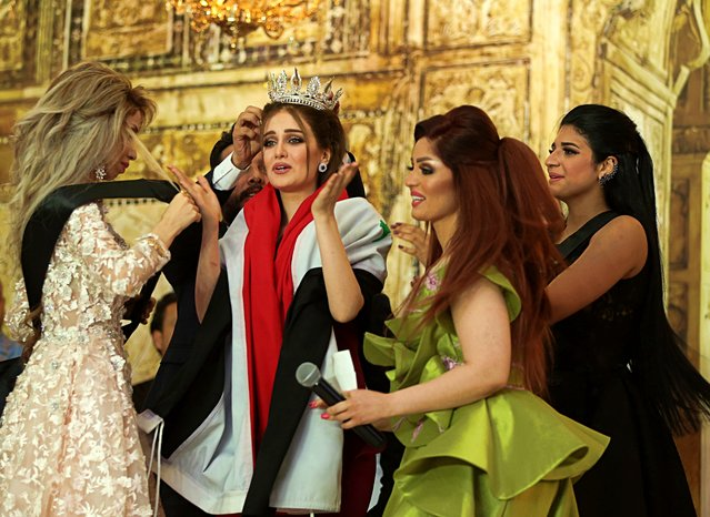 Vian Salman, center, reacts with fellow contestants after she was crowned the new Miss Iraq during the Miss Iraq contest in Baghdad, Iraq, Thursday, May 25, 2017. (Photo by Karim Kadim/AP Photo)