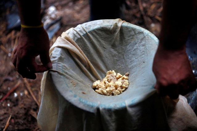 A worker strains coca paste at a small farm in Guayabero, Guaviare province, Colombia, May 23, 2016. (Photo by John Vizcaino/Reuters)