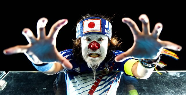 A Japan fan shows support prior to the 2014 FIFA World Cup Brazil Group  C match between Japan and Greece at Estadio das Dunas on June 19, 2014 in Natal, Brazil. (Photo by Laurence Griffiths/Getty Images)