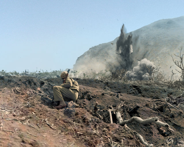 US Marine watches as Japanese forces are shelled on Iwo Jima, ca. Feb-Mar 1945. (Photo by Jared Enos/Mediadrumworld.com)