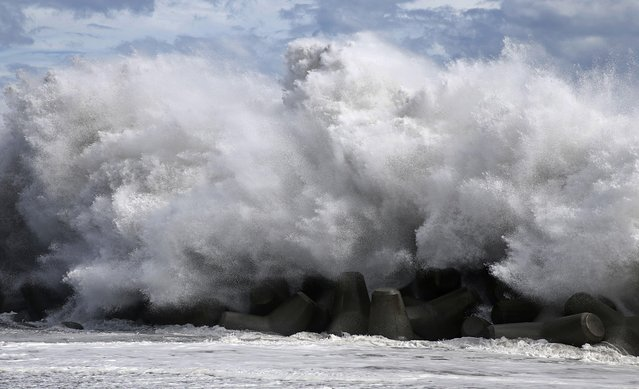 In this September 8, 2019, photo, a high wave hits breakwater at the port as typhoon approaches in Shizuoka city, central Japan. (Photo by Kyodo News via AP Photo)