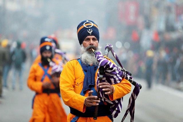 Indian Sikh devotees perform a brass band during a religious procession ahead of the birth anniversary of Guru Gobind Singh in Jammu, India, Monday, December 30, 2019. The birth anniversary of the tenth Sikh guru, will be marked on Jan. 2. (Photo by Channi Anand/AP Photo)