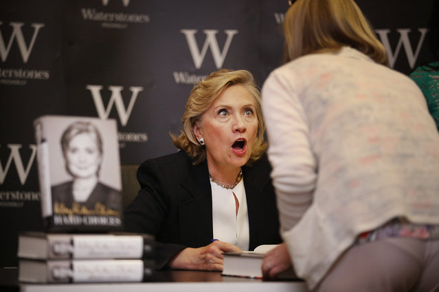 Former US Secretary of State Hillary Clinton looks up at a customer as she signs copies of her new book at Waterstones bookshop on July 3, 2014 in London, England. Mrs Clinton's book entitled 'Hard Choices' is reportedly only selling in small numbers. (Photo by Peter Macdiarmid/Getty Images)
