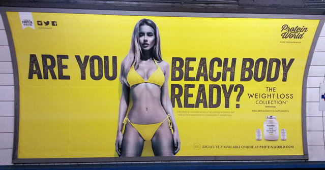 "This is an April 27, 2015 file photo of a Protein World advert displayed in an underground station in London. London Mayor Sadiq Khan has banned advertising that promotes unhealthy body image on the city's subway network. Starting July 2016, Transport for London will not allow ads that cause pressure to conform to ""unrealistic or unhealthy body shape"". (Photo by Catherine Wylie/PA Wire via AP Photo)"