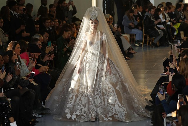 A model presents a wedding dress creation by designer Elie Saab as part of his Haute Couture Spring/Summer 2020 collection show in Paris, France, January 22, 2020. (Photo by Francois Lenoir/Reuters)