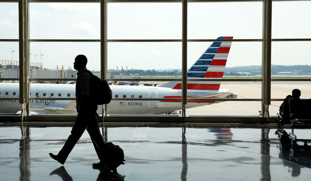 A passenger makes his way through Reagan National Airport at the start of the Independence Day holiday weekend in Washington, U.S., July 1, 2016. (Photo by Kevin Lamarque/Reuter