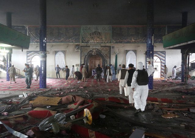Afghan men inspect inside of the mosque after a suicide attack followed by a clash between Afghan forces and insurgents after an attack on a Shi'ite Muslim mosque in Kabul, Afghanistan on Friday, August 25, 2017. (Photo by Omar Sobhani/Reuters)
