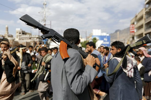 A Houthi follower carries his rifle as he performs with others the traditional Baraa dance ahead of a demonstration against the Saudi-led air strikes in Yemen's capital Sanaa August 24, 2015. (Photo by Khaled Abdullah/Reuters)