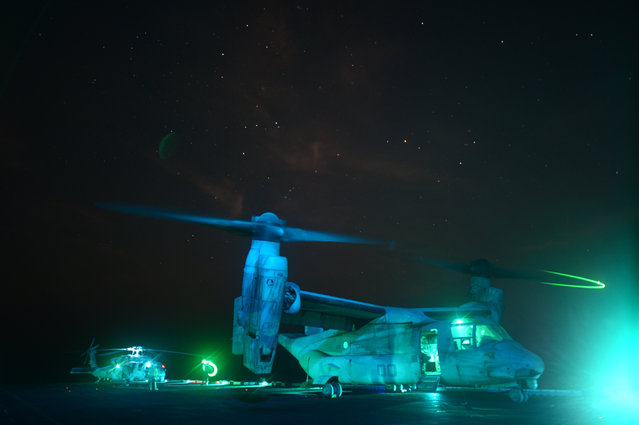 An MV-22 Osprey prepares to take off from the flight deck of the amphibious assault ship USS Kearsarge (LHD 3). Kearsarge is the flagship for the Kearsarge Amphibious Ready Group and, with the embarked 26th Marine Expeditionary Unit, is deployed in support of maritime security operations and theater security cooperation efforts in the U.S. 5th Fleet area of responsibility. (Photo by Mass Communication Specialist 3rd Class Chelsea Mandello/U.S. Navy photo)