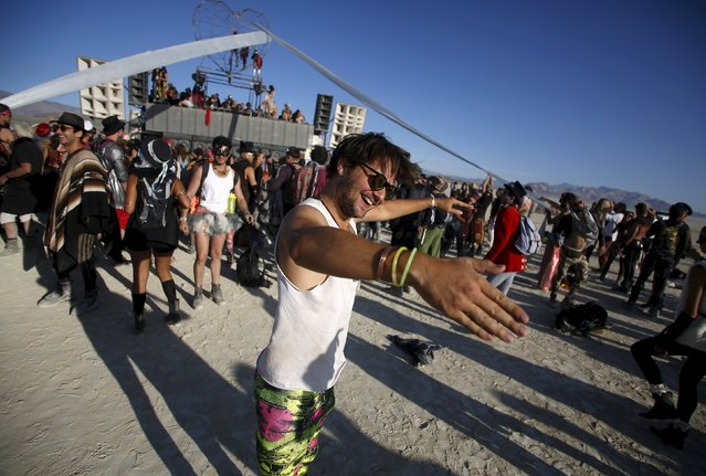"""Markus dances at the Robot Heart during the morning hours at the Burning Man 2015 """"Carnival of Mirrors"""" arts and music festival in the Black Rock Desert of Nevada, August 31, 2015. (Photo by Jim Urquhart/Reuters)"""