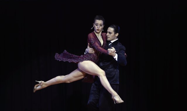 Manuela Rossi (L) and Juan Malizia Gatti from Argentina compete during the final round before winning the Tango World Championship in Stage style in Buenos Aires August 26, 2014. (Photo by Marcos Brindicci/Reuters)