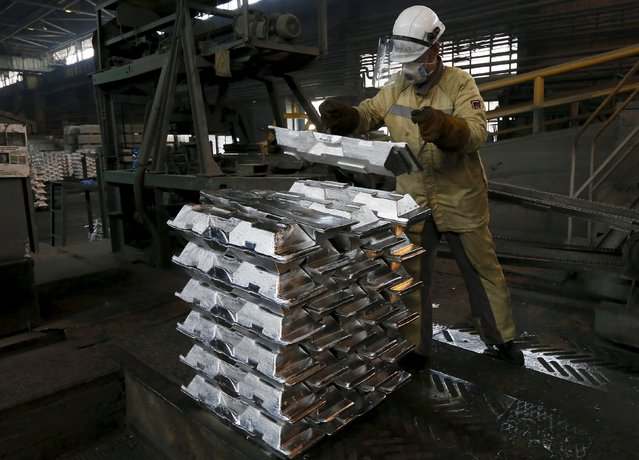 A worker stacks aluminium ingots at the foundry shop of the Rusal Sayanogorsk aluminium smelter outside the town of Sayanogorsk, Russia, September 3, 2015. (Photo by Ilya Naymushin/Reuters)
