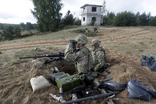 "Danish troops take part in live fire exercise in a tactical environment ahead of the ""Silver Arrow"" drill in Adazi training field, Latvia,  September 5, 2015. (Photo by Ints Kalnins/Reuters)"