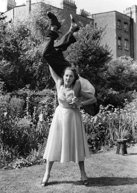 Stuntwoman Connie Tilton, tough girl of British films, swings a man round on her shoulders. 18th August 1953. (Photo by Keystone)
